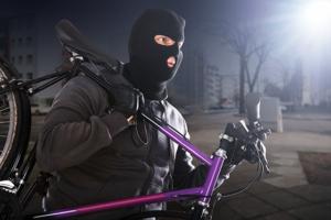 Illustration av pågående cykelstöld. Foto.